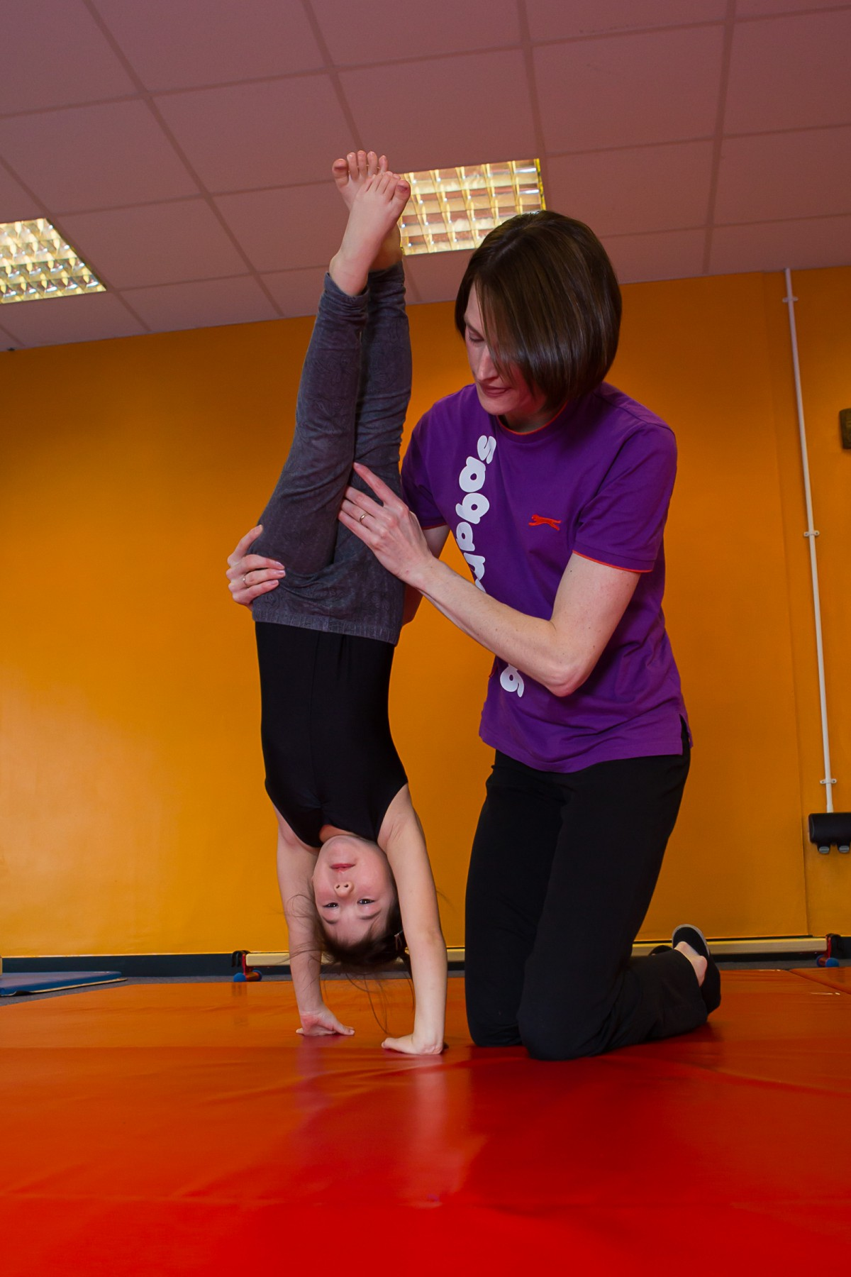 handstand with instructor